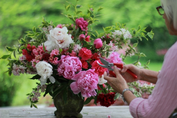 Spring Design by Jane using chicken wire for mechanic, featuring peonies and materials from her garden