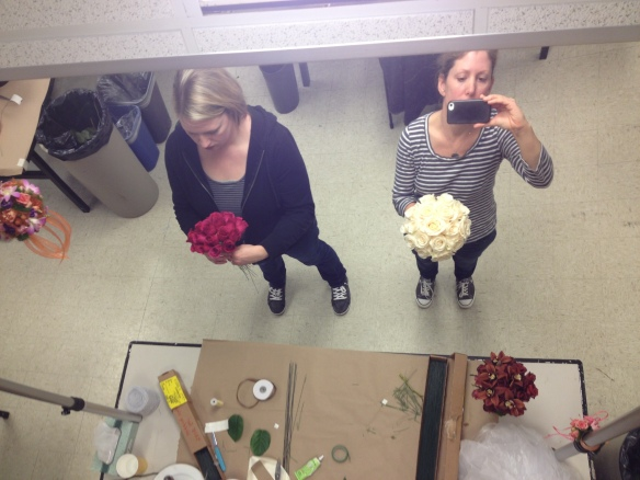 Here a fellow classmate and I check to see if our bouquets are symmetrical in the mirror