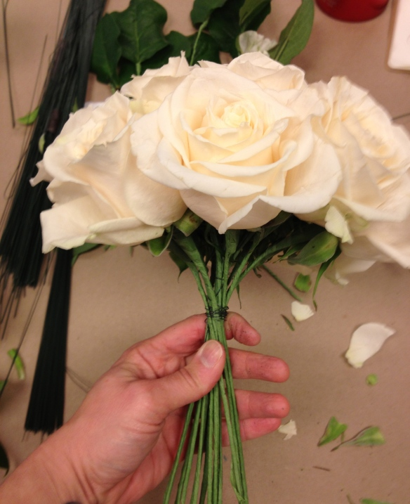 Place each stem at an angle to the center flower and turn.  Wire as you go to give your hand a break.