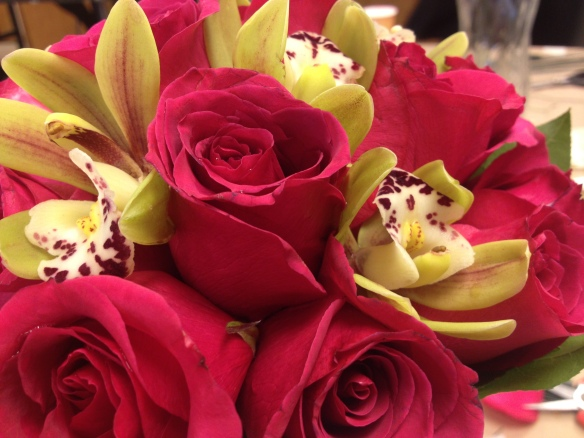 Fuschia roses combined with chartreuse cymbidium orchids - wild and modern!