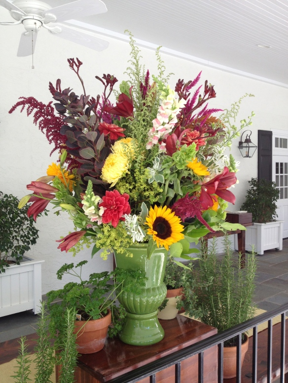 Large urn with a lot of locally grown flowers