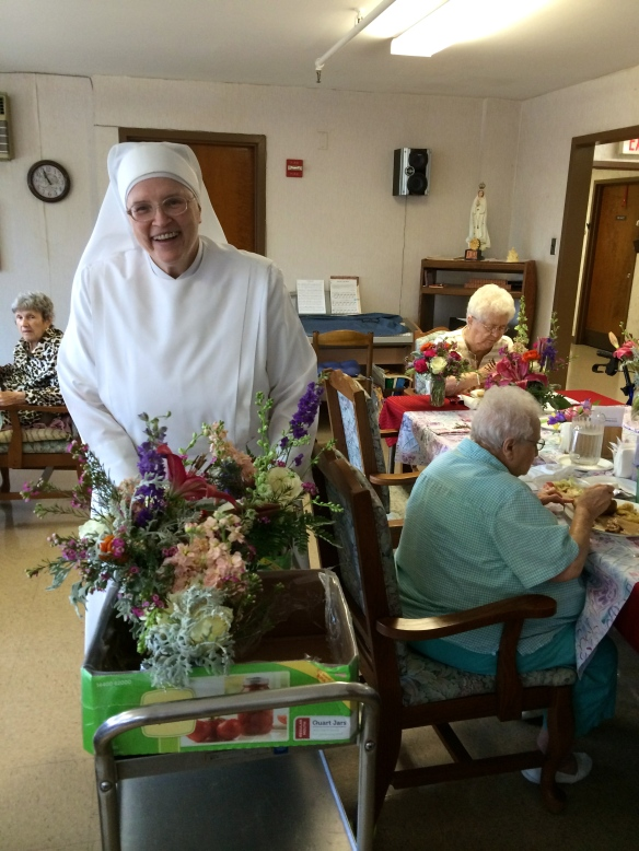 Sister Elizabeth Ann distributing arrangements