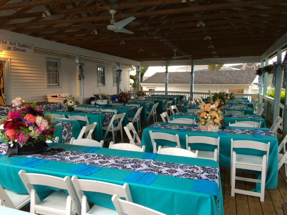 Preferred seating and Luncheon area displaying floral centerpieces in hat boxes